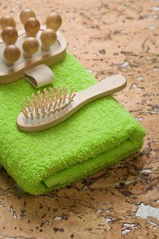 Massager And Hairbrush On Green Towel Royalty Free Stock Photos