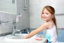 Free Girl Washing In Bathroom Royalty Free Stock Photography - 17350837