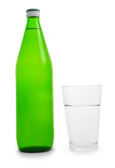 Green Bottle And Glass Of Water Stock Image