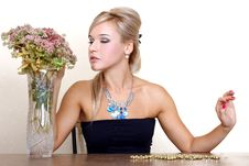 Free Woman Looking A Autumn Flowers Royalty Free Stock Images - 17351949