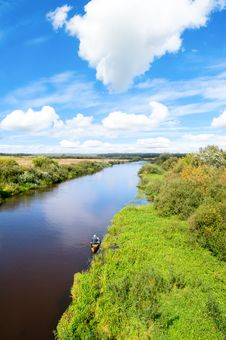 Blue River, Cloud Sky, Green Shores. Royalty Free Stock Photography