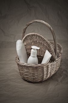 Basket With Bottles And Tube Royalty Free Stock Image