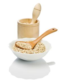 Free Cereals In Dish With Spoon And Mortar Stock Photo - 17352920