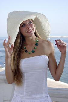 Happy Blonde In A Hat Over Sea