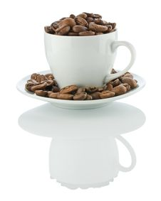 Free Cup On The Suaser With Coffee Beans Royalty Free Stock Photos - 17354458