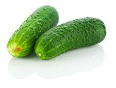 Fresh Dropped Cucumbers Royalty Free Stock Photos