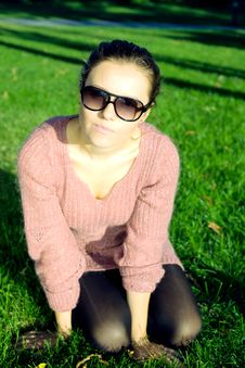 Free Attractive Young Woman Sitting On Green Grass Royalty Free Stock Photography - 17354707