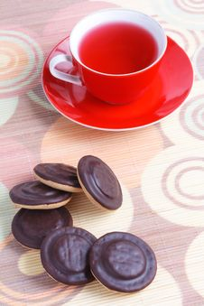 Free Cup Of Tea And Chocolate Iced Cookies Royalty Free Stock Images - 17354899