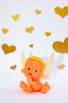 Free Funny Shy Toy Angel On Background With Hearts Stock Photos - 17354903