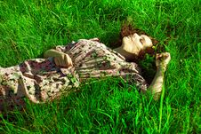 Free A Beautiful Girl Lies In A Green Grass Royalty Free Stock Image - 17355396