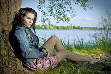 Free Beautiful Young Woman Relaxing Near River Royalty Free Stock Photo - 17355425
