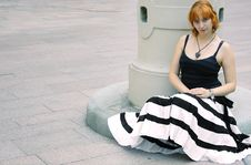 Young Red Woman In Flared Striped Black And White Stock Image
