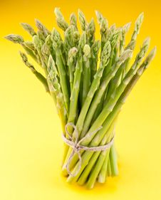 Sheaf Of Asparagus On A Yellow. Royalty Free Stock Photo