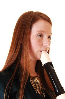 Girl Playing Flute. Stock Photos