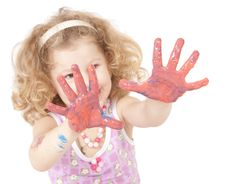 Little Girl With Paint Hands Isolated On White