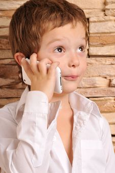 Boy Talking On The Phone Royalty Free Stock Photos