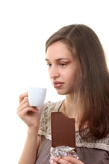 Free Woman Drink Coffee With A Chocolate Royalty Free Stock Image - 17357576