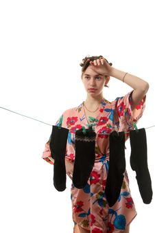 Free Housewife Hangs Up Socks On  The Clothesline Royalty Free Stock Photos - 17357578