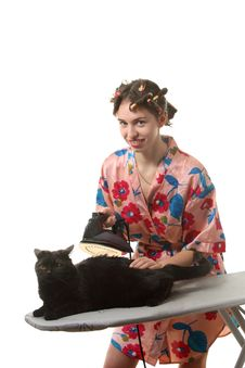 Housewife With Ironing A Cat Stock Photography