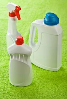 Three White Bottles On Green Background Stock Photos