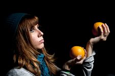 Girl With Orange And Hat Stock Photography