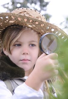 Free Girl With Magnifying Glass Stock Photos - 17357983