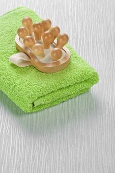 Massager On Green Towel Stock Images