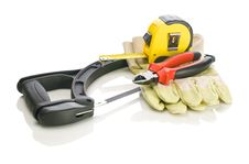 Tapeline Pliers Gloves On Hacksaw Stock Image