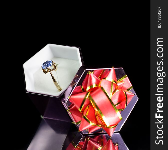 Gold ring in a gift box