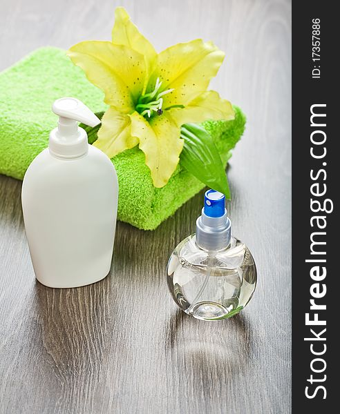 Towel with flower  and bottles