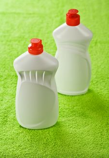 Free Two Plastic Bottles On Green Towel Stock Image - 17360041