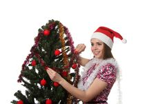 Free Woman Decorate A Christmas Tree Royalty Free Stock Image - 17360126