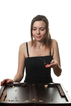 Woman Play Backgammon Stock Photography