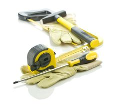 Free Gloves With Stack Of Tools Royalty Free Stock Image - 17360546