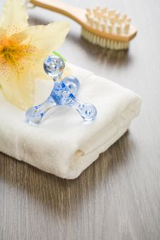 Free Flower And Massager On White Towel With Massager Stock Images - 17361824