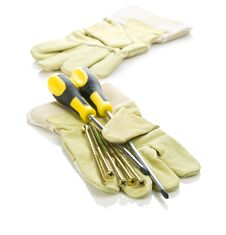 Free Screws And Screwdrivers With Gloves Royalty Free Stock Images - 17363919
