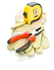 Gloves With Tapeline And Pliers Stock Images