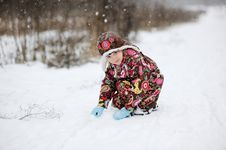 Free Small Girl In Strong Snow Fall Stock Photos - 17365193