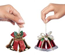 Free Christmas Bells With Ribbon Hold By Hand Stock Photo - 17366750