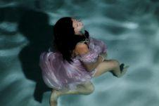 Running Underwater In Dress Stock Photo