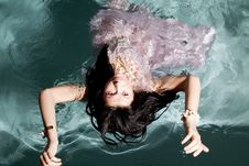 Free Woman In Water Back In Dress Royalty Free Stock Photography - 17367787