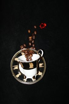 Coffee Beans Are Flying Into The Cup Royalty Free Stock Photography