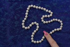 Pearl Beads On The Blue Cloth Royalty Free Stock Photography