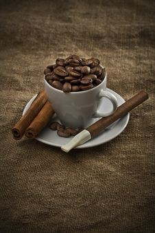 Free Cup With Beans Cigar And Cinnamon Royalty Free Stock Photo - 17369005