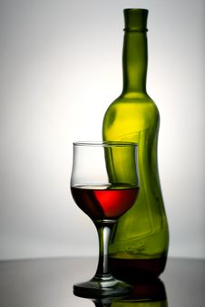 Free Wineglass And Bottle On The Desk. Royalty Free Stock Image - 17369256