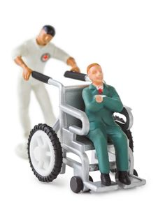 Free Toy Wheelchair Royalty Free Stock Photo - 17369945