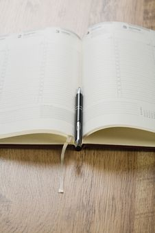 Free Open Notebook With Pen Stock Photography - 17370082