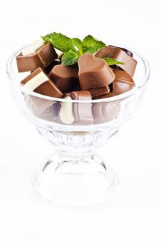 Free Glass Bowl Of Chocolates And Mint Stock Images - 17373434