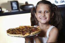 Smiling Girl With Pizza Stock Photos