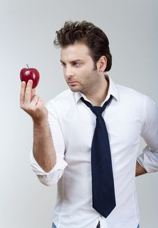 Free Man Holding Red Apple Stock Images - 17373984